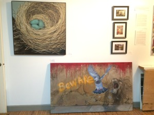 """A couple of older paintings. The nest, """"Waiting to Crack,"""" is in acrylic, and the Beware painting is mostly done with my faux finish plasters, spray paint and chalk. The bird area I masked off so it would be smooth. This piece is called, """"What City Birds Hate, Scary Graffiti."""""""